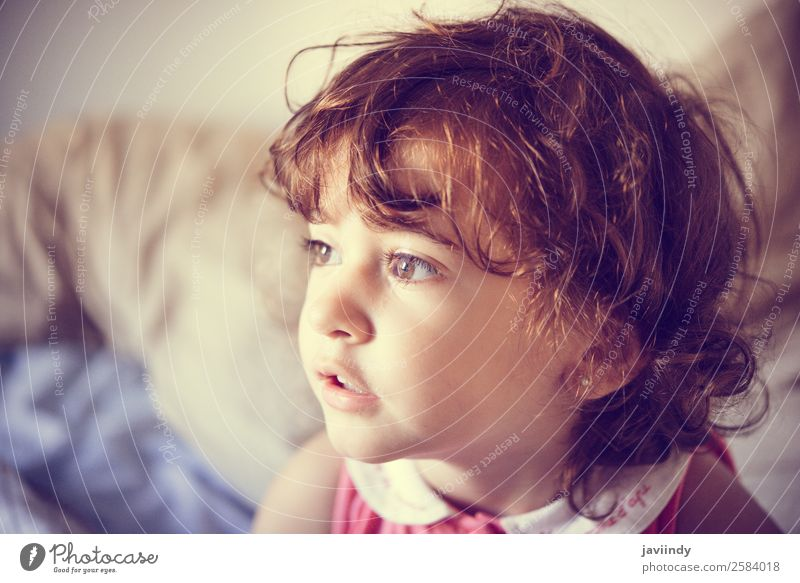 Adorable little girl with curly hair tousled at home Lifestyle Joy Happy Beautiful Face Child Human being Girl Woman Adults Infancy 1 1 - 3 years Toddler