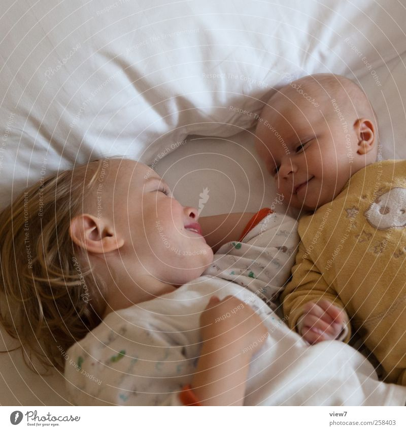 Human being Child Girl Relaxation Happy Laughter Family & Relations Infancy Contentment Baby Safety Bed Communicate Observe Touch Smiling