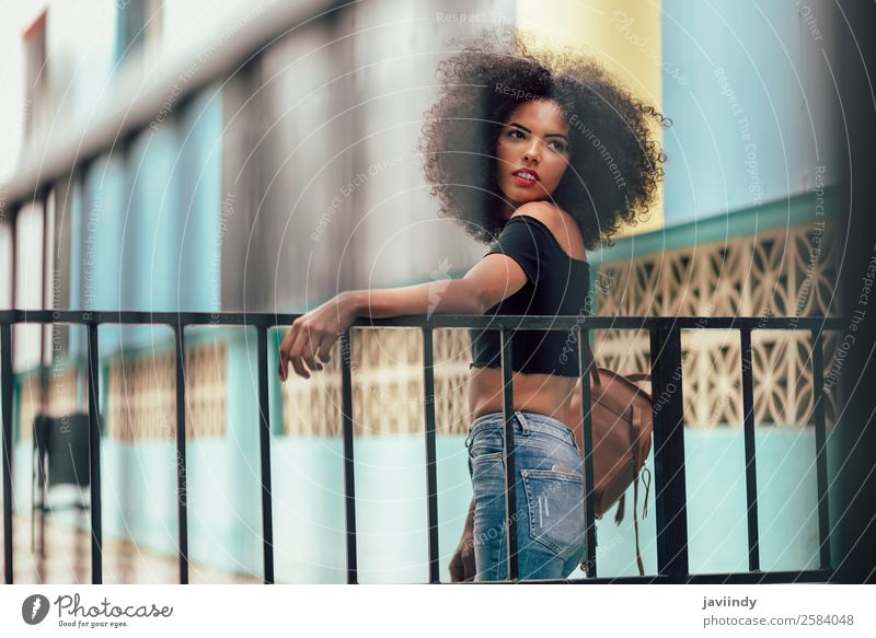Young mixed woman with afro hair standing on the street. Lifestyle Style Beautiful Hair and hairstyles Face Human being Feminine Young woman