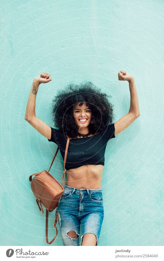 Funny black woman with afro hair raising arms outdoors Woman Human being Youth (Young adults) Young woman Beautiful Joy Black 18 - 30 years Face Street