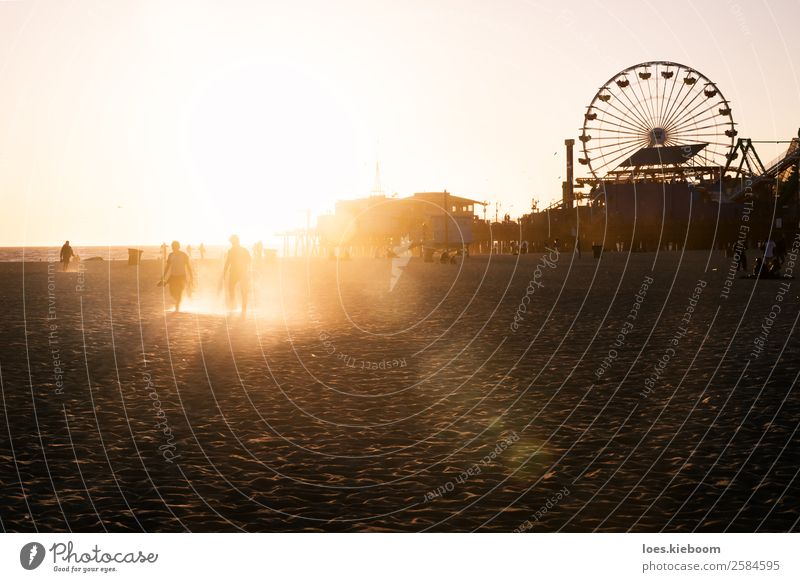 Silhouettes of people walking along Santa Monica pier Joy Vacation & Travel Summer Beach Human being 2 Nature Landscape Sand Sun Spring Ocean Manmade structures