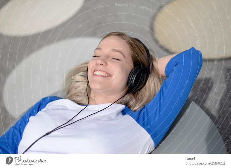 Woman Youth (Young adults) Young woman Blue Beautiful White Relaxation Joy Lifestyle Adults Laughter Happy Contentment Leisure and hobbies Music Blonde