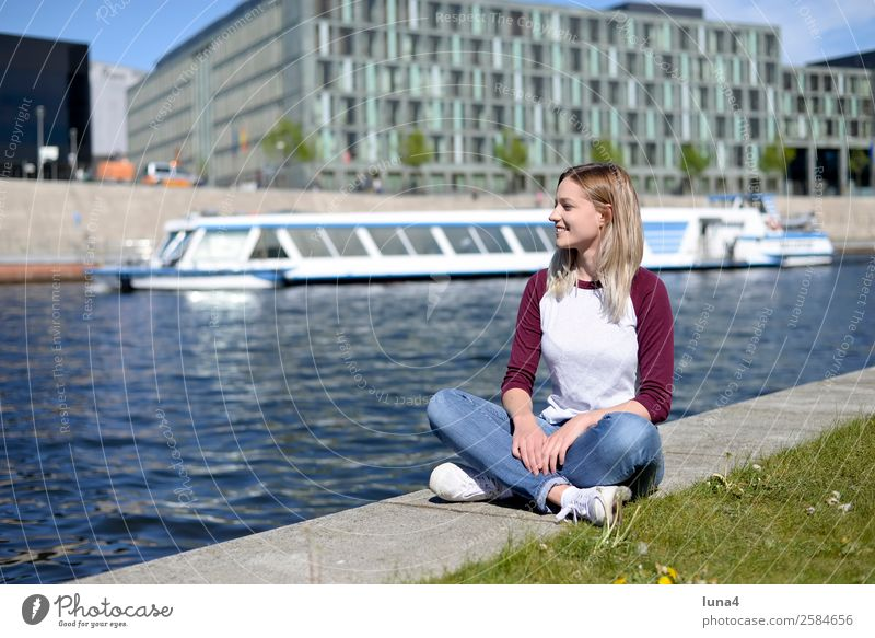 Woman sits at the river Lifestyle Joy Happy Beautiful Contentment Relaxation Leisure and hobbies Tourism Summer Young woman Youth (Young adults) Adults