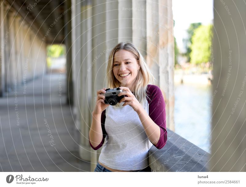 Woman with old camera Lifestyle Joy Happy Beautiful Contentment Leisure and hobbies Tourism Summer Camera Young woman Youth (Young adults) Adults Water River