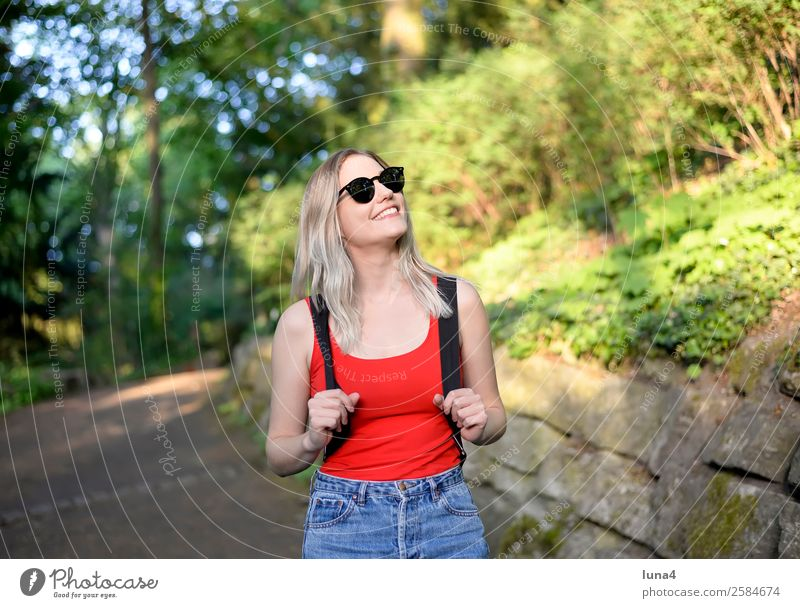 Young woman in the park Lifestyle Joy Happy Beautiful Contentment Relaxation Leisure and hobbies Tourism Summer Hiking University & College student
