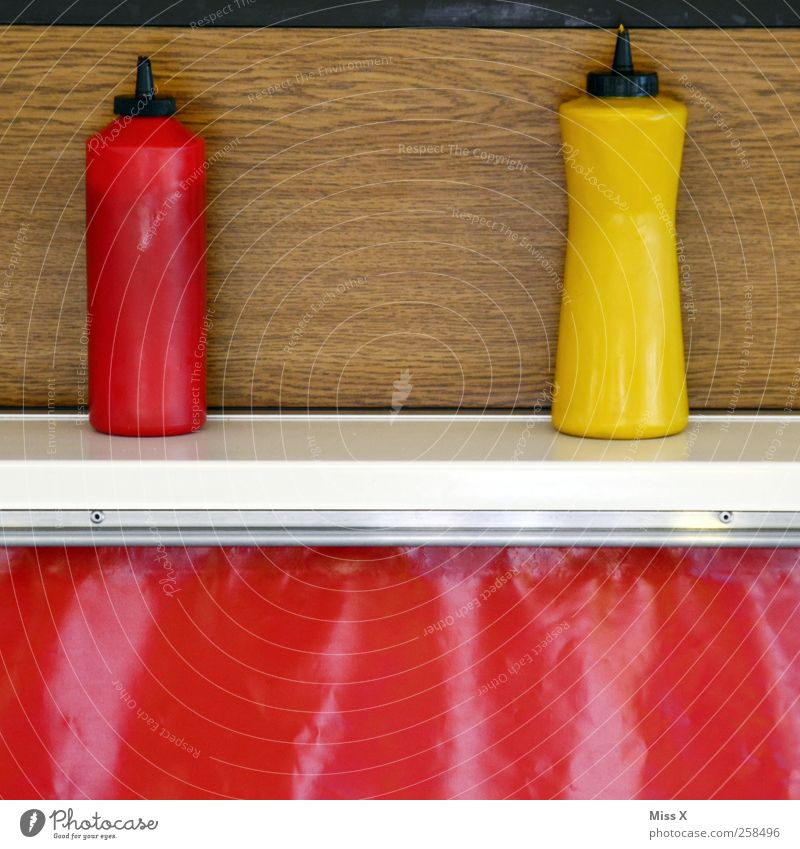 Ketchup & Mustard Food Nutrition Fast food Yellow Red Snack bar sausage stall Stalls and stands Bottle Tangy Colour photo Multicoloured Close-up Deserted