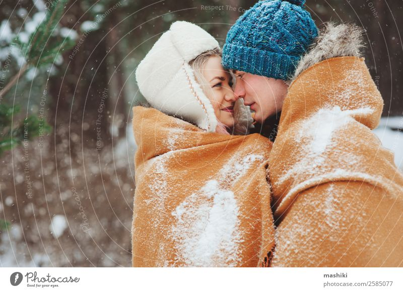 happy young loving couple walking in snowy winter Joy Vacation & Travel Adventure Freedom Winter Snow Woman Adults Man Couple Nature Snowfall Park Forest