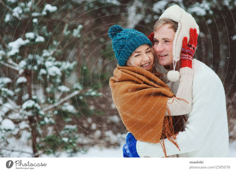 happy young loving couple walking in snowy winter forest Lifestyle Joy Vacation & Travel Adventure Freedom Winter Snow Winter vacation Woman Adults Man Couple