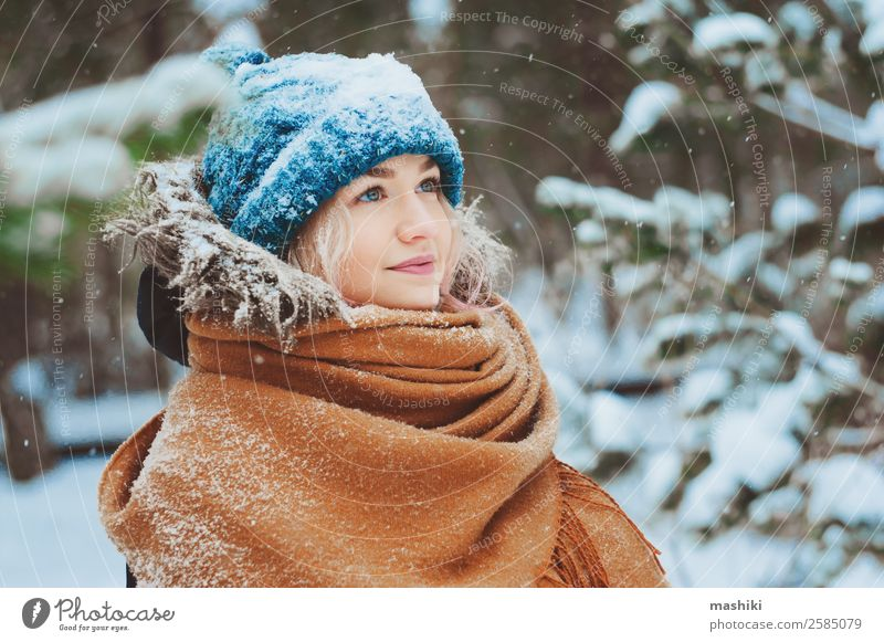 winter portrait of happy young woman Joy Vacation & Travel Adventure Freedom Winter Snow Woman Adults Nature Snowfall Warmth Tree Park Forest Fashion Clothing