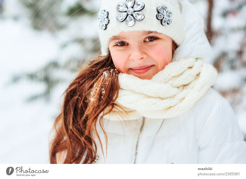 Winter close up portrait of cute dreamy child girl Child Vacation & Travel Nature Tree Joy Forest Warmth Snow Laughter Freedom Snowfall Park Dream Infancy
