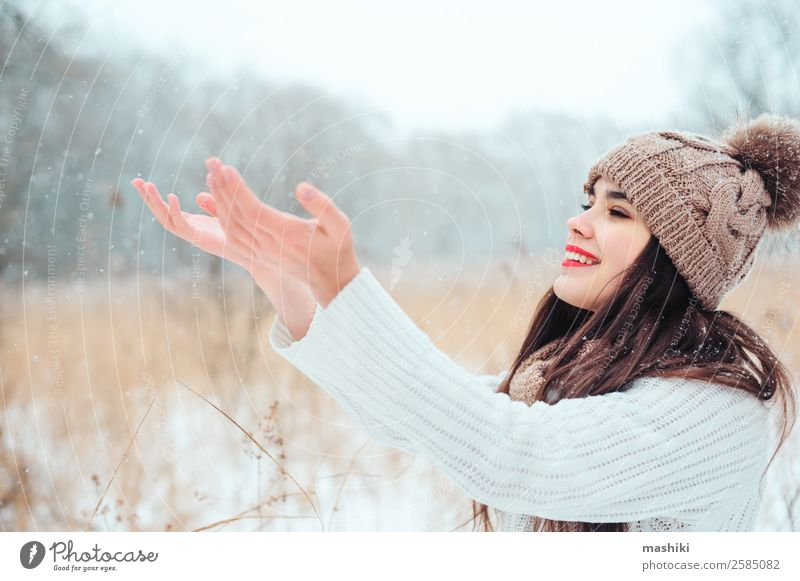 happy woman catching snowflakes on the walk Style Joy Happy Face Make-up Lipstick Knit Vacation & Travel Winter Snow Feminine Woman Adults Nature Weather