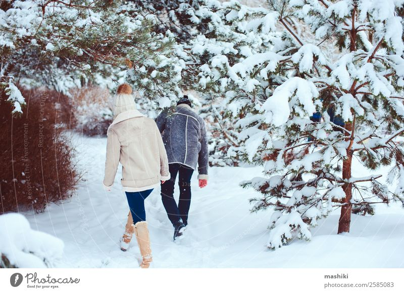Lifestyle winter portrait of romantic couple walking Joy Vacation & Travel Adventure Freedom Winter Snow Couple Adults Nature Snowfall Park Forest Gloves