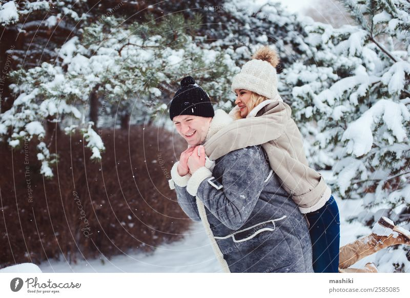 Lifestyle winter portrait of romantic couple walking Vacation & Travel Adventure Freedom Winter Snow Woman Adults Man Couple Nature Snowfall Park Forest Gloves
