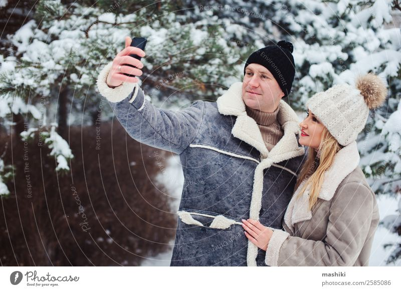 happy romantic couple making selfie outdoor in snowy winter Lifestyle Joy Vacation & Travel Adventure Freedom Winter Snow Woman Adults Man Couple Nature