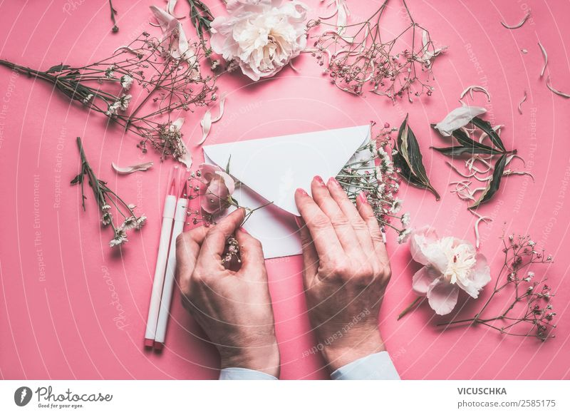 Hands decorate envelope with flowers Lifestyle Elegant Style Design Feasts & Celebrations Valentine's Day Mother's Day Wedding Birthday Feminine Woman Adults