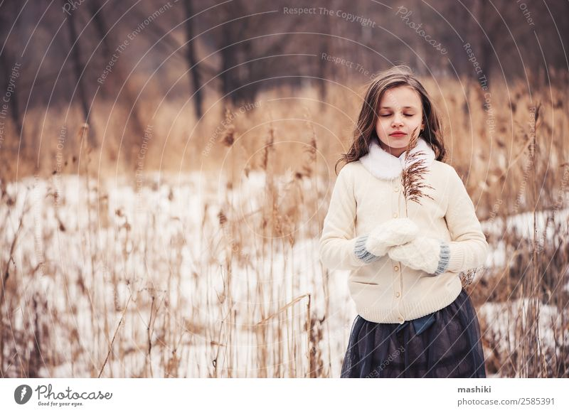 dreamy child girl walking in winter forest Joy Beautiful Leisure and hobbies Winter Snow Child Infancy Weather Tree Forest Fashion Coat Fur coat Scarf Gloves