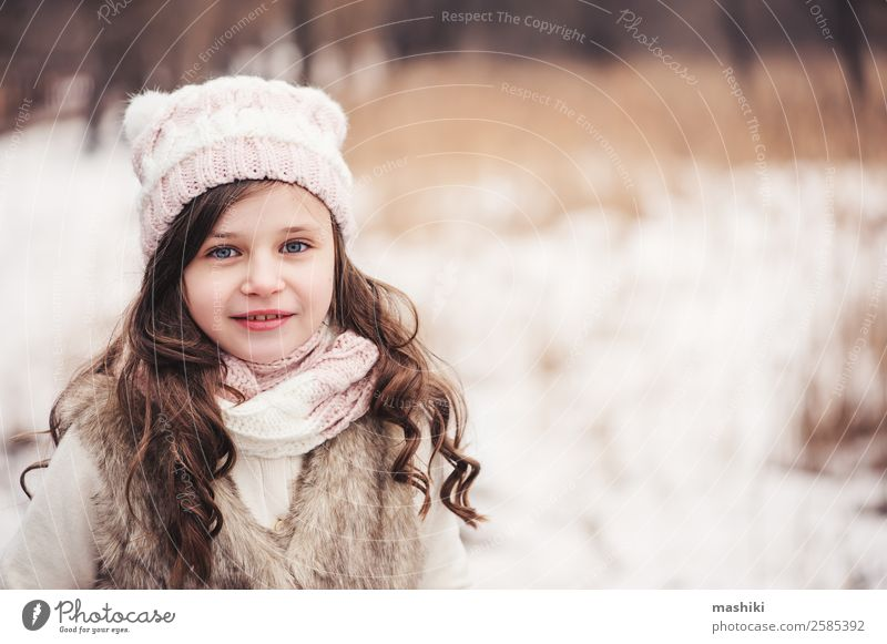 winter portrait of happy kid girl walking Child Beautiful White Tree Joy Forest Winter Snow Small Fashion Leisure and hobbies Weather Infancy Cute Seasons Frost