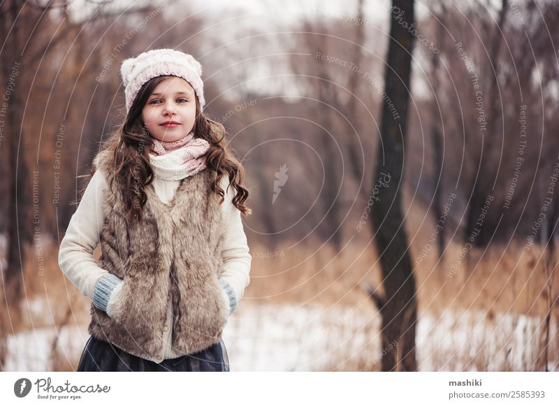 winter portrait of happy kid girl walking Lifestyle Joy Leisure and hobbies Vacation & Travel Winter Snow Child Infancy Weather Forest Fashion Hat Smiling