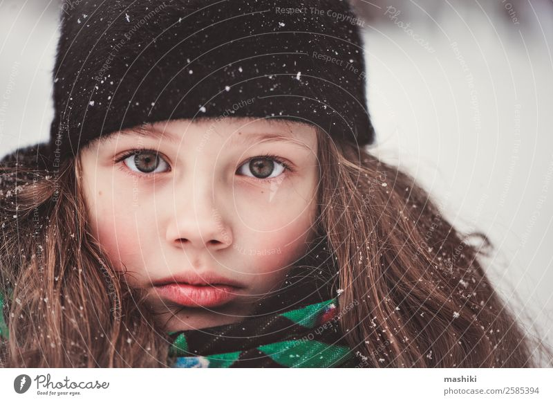 winter portrait of dreamy child girl Beautiful Child Girl Face 8 - 13 years Infancy Winter Weather Snow Snowfall Park Forest Walking Action Delightful Caucasian