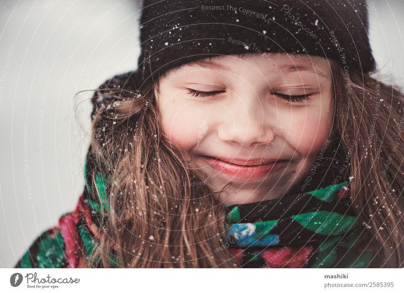 close up winter portrait of happy kid girl Child Beautiful Joy Girl Winter Funny Snow Happy Freedom Snowfall Smiling Action To enjoy Adventure Walking Seasons
