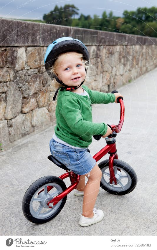 Little kid riding his bike down the street Lifestyle Joy Happy Leisure and hobbies Playing Summer Sports Cycling Child Human being Baby Toddler Boy (child)