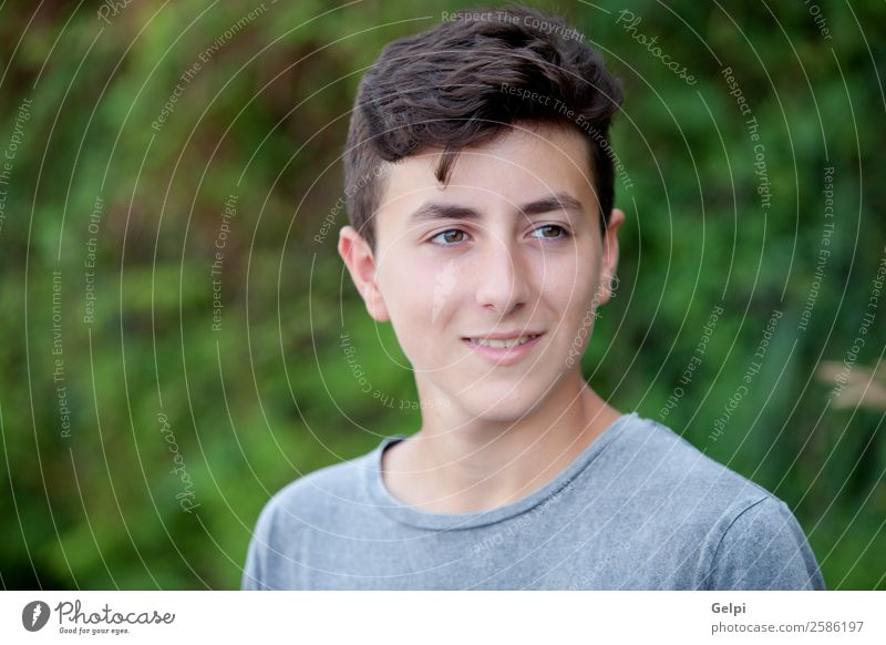 Handsome brown-haired teen Lifestyle Style Happy Face Summer Human being Boy (child) Man Adults Youth (Young adults) Culture Nature Park Fashion Smiling