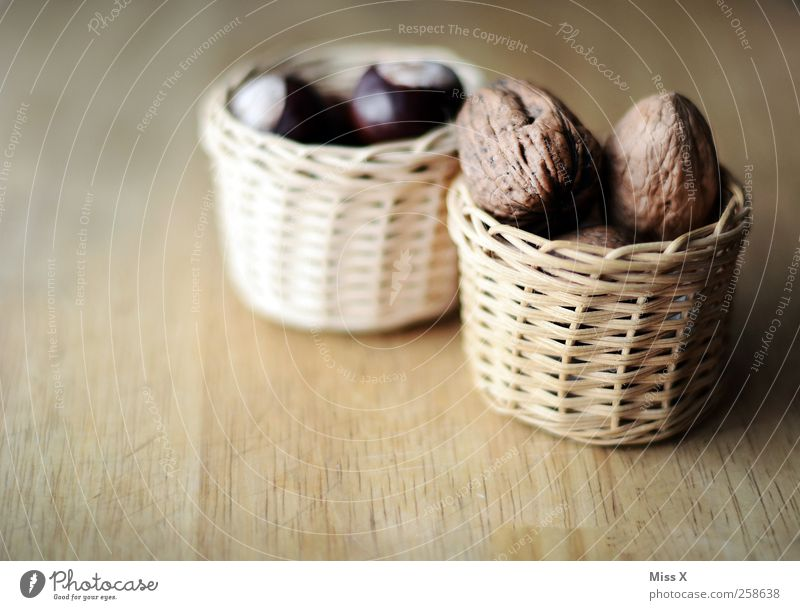 small basket Food Nutrition Bowl Delicious Brown Walnut Basket Chestnut Tree fruit Wood Wooden board Colour photo Subdued colour Close-up Deserted