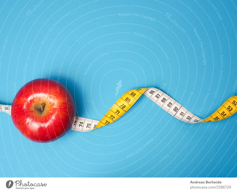 One apple a day Fruit Apple Organic produce Vegetarian diet Diet Fasting Lifestyle Healthy Eating Overweight Christmas & Advent Tape measure Fitness Yellow Red