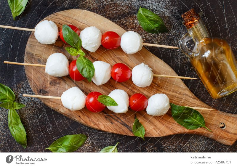 Italian cheese mozzarella with tomatoes, basil and olive oil Nutrition Vegetarian diet Bottle Ball Dark Fresh Bright Delicious Soft Green Red White Tradition