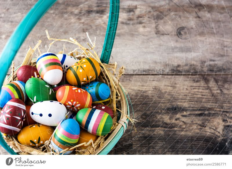 Easter eggs in a basket and tulips on wooden background Egg Colour Vacation & Travel Feasts & Celebrations Public Holiday Background picture Guest Decoration