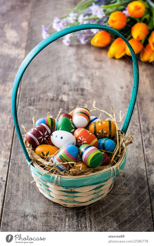 Easter eggs in a basket and tulips on wood Egg Colour Vacation & Travel Feasts & Celebrations Public Holiday Background picture Guest Decoration Festive Spring