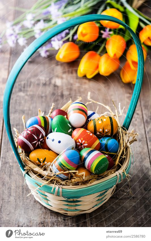 Easter eggs in a basket and tulips on wood Vacation & Travel Colour Flower Background picture Wood Spring Feasts & Celebrations Decoration Tradition Egg