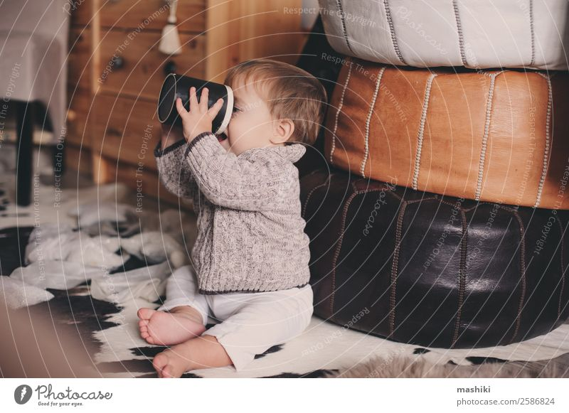 cute baby boy playing with cup at home Tea Lifestyle Style Happy Playing Winter Bedroom Child Baby Boy (child) Infancy Warmth Sweater Sit Small Modern Cute Home