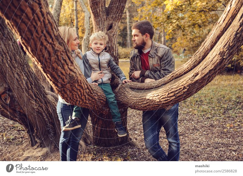 happy family spending time together outdoor. Nature Vacation & Travel Summer Tree Forest Lifestyle Adults Warmth Autumn Love Family & Relations Happy