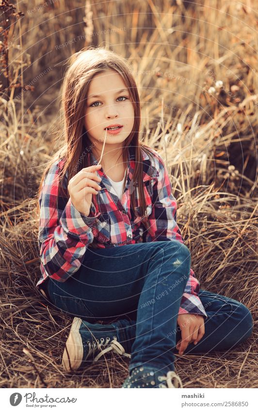 adorable kid girl in plaid shirt on sunny summer field Joy Relaxation Vacation & Travel Summer Child Woman Adults Infancy Nature Autumn Weather Warmth Leaf