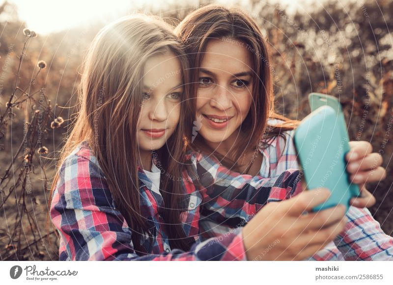 happy mother and daughter making selfie outdoor Lifestyle Joy Happy Vacation & Travel Summer Telephone Parents Adults Mother Family & Relations Nature Autumn