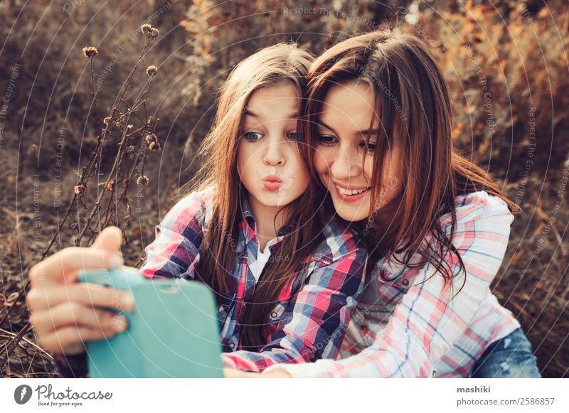 happy mother and daughter making selfie outdoor Lifestyle Joy Vacation & Travel Summer Telephone Parents Adults Mother Family & Relations Nature Autumn Meadow