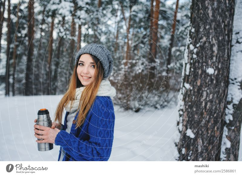 beautiful young woman relaxing on winter walk Lifestyle Joy Relaxation Vacation & Travel Winter Snow Winter vacation Woman Adults Nature Weather Snowfall Tree