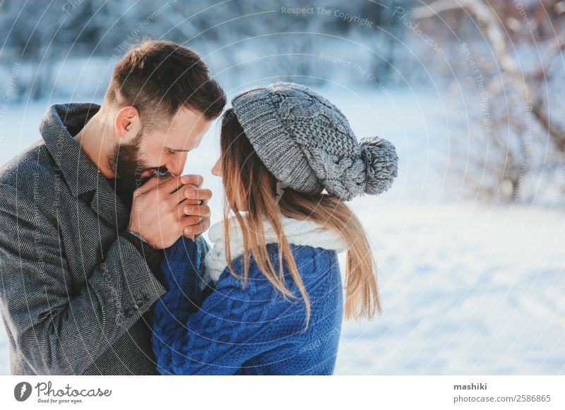 lifestyle shot of happy couple walking in snowy forest Lifestyle Joy Leisure and hobbies Vacation & Travel Freedom Winter Snow Man Adults Couple Fashion Scarf