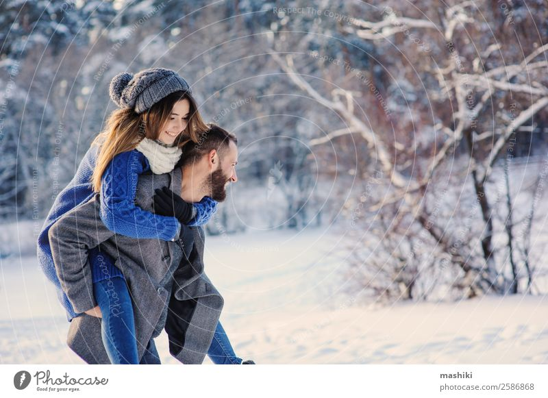 happy loving couple walking in snowy winter forest Lifestyle Joy Leisure and hobbies Vacation & Travel Freedom Winter Snow Man Adults Couple Forest Hat Beard