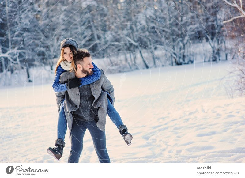 happy loving couple walking in snowy winter forest Lifestyle Joy Relaxation Leisure and hobbies Vacation & Travel Freedom Winter Snow Man Adults Couple Forest