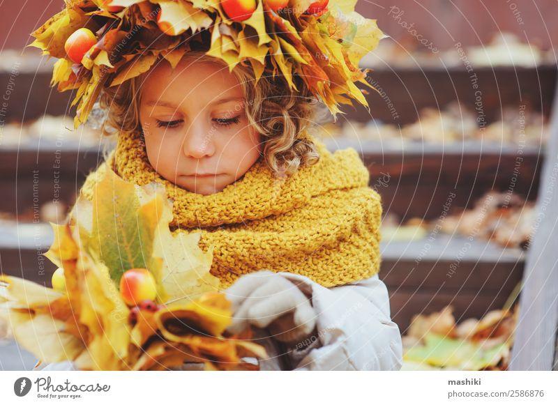 cute child girl on autumn walk in wreath Child 3 - 8 years Infancy Adventure Autumn Walking Orange Warmth Nature Childhood dream Girl Leaf Seasons Cute Small