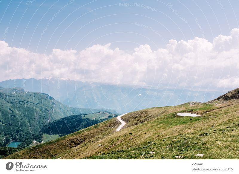 Monte Baldo Lake Garda. Environment Nature Landscape Sky Clouds Summer Beautiful weather Grass Alps Mountain Peak Sustainability Natural Blue Green Calm
