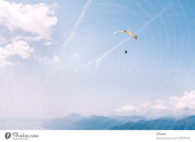 Paragliding | Lake Garda Leisure and hobbies Vacation & Travel Adventure Mountain Sports Parachute Human being 1 Nature Landscape Sky Clouds Summer