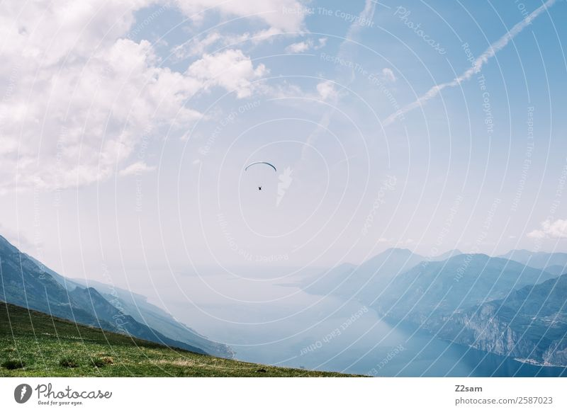 Human being Sky Nature Vacation & Travel Summer Blue Green Landscape Clouds Far-off places Mountain Natural Sports Lake Flying Trip