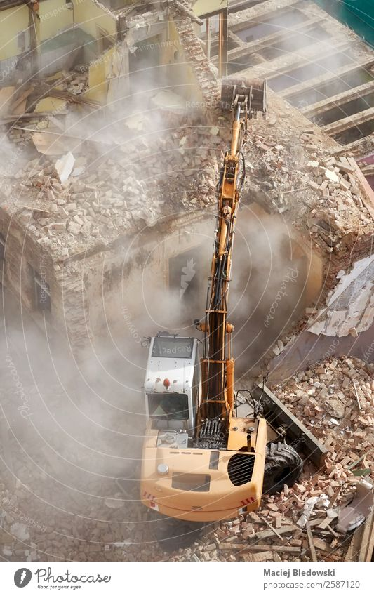 Building demolition with an excavator in dust cloud. House (Residential Structure) Construction site Machinery Ruin Work and employment Death Survive Decline