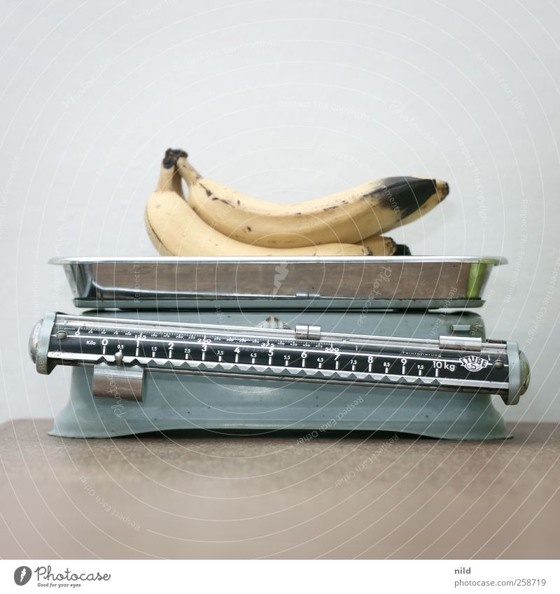 Bananas on scales Food Fruit Nutrition Organic produce Vegetarian diet Decoration Kitsch Odds and ends Scale Kitchen Weight Metal Blue Brown Yellow Transience