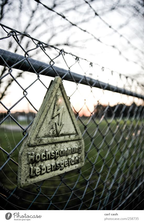 Old Green Yellow Warmth Signs and labeling Dangerous Electricity Safety Threat Signage Protection Fence Loop Nuclear Power Plant Warning sign Wire netting fence