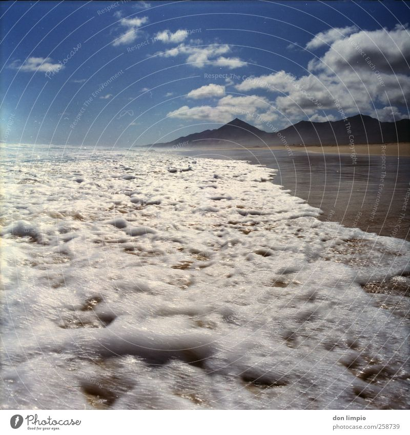 Blue Water Vacation & Travel Ocean Summer Beach Clouds Far-off places Mountain Moody Horizon Waves Wet Trip Wild Island