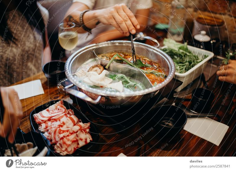 Korean hot pot dish meal at the restaurant Food Meat Seafood Vegetable Soup Stew Eating Pot Lifestyle Vacation & Travel Winter Restaurant Human being Hand 3 Hot